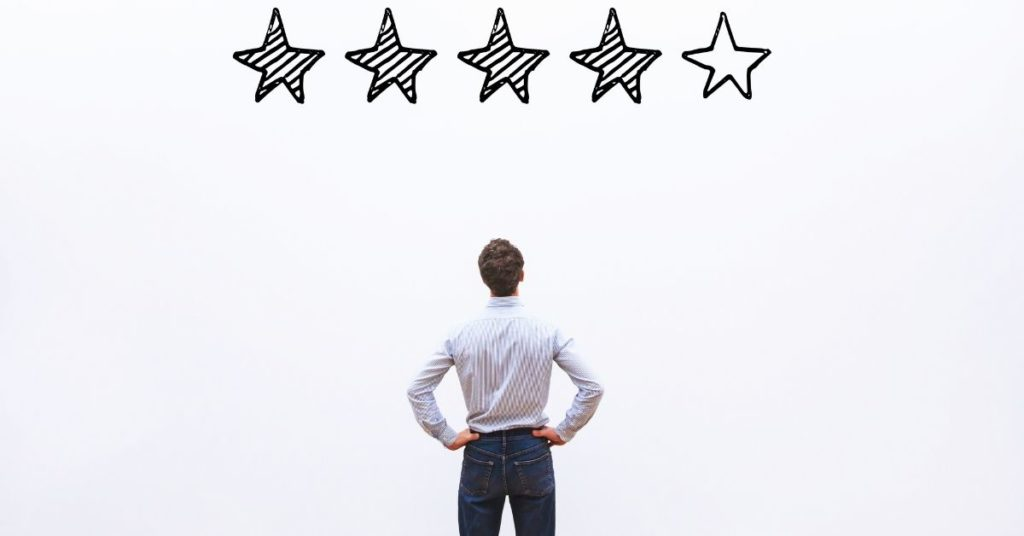 man staring at 5 star review