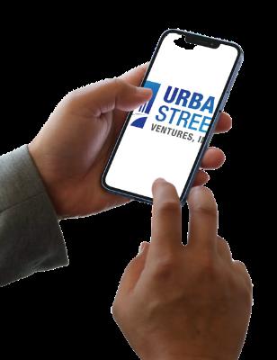 man holding phone image of urban street logo